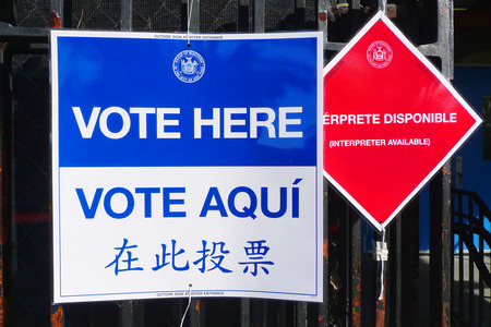 NEW YORK - NOVEMBER 5: Signs at the voting site in New York on November 5, 2013.The Voting Rights Act of 1965 is a national legislation in the United States that prohibits discrimination in voting