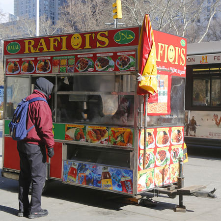 NEW YORK - FEBRUARY 19, 2015: Street vendor cart in Manhattan. There are about 4,000 mobile food vendors licensed by the city