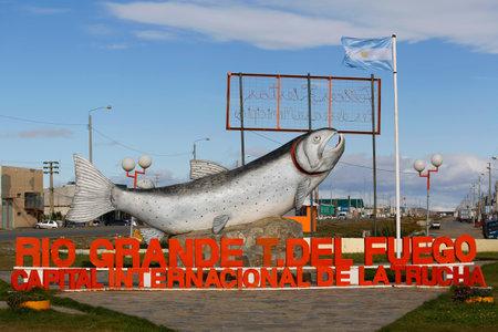 RIO GRANGE, ARGENTINA - APRIL 3, 2015: Sign Rio Grande Trout s International Capital in Rio Grande, Argentina. Rio Grande is a city in Argentina on the Isla Grande de Tierra del Fuego