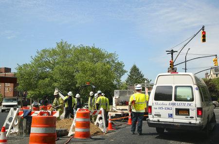 BROOKLYN, NEW YORK - MAY 19, 2016: National Grid crew workers make emergency repair in Brooklyn, New York.