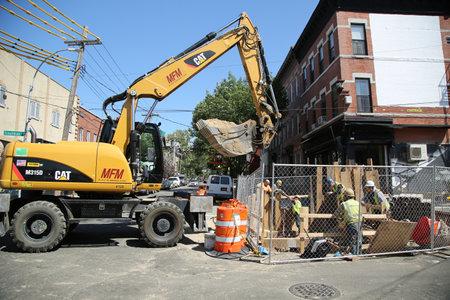 BROOKLYN, NEW YORK - JUNE 9, 2016: Constriction workers repair street in Brooklyn, New York