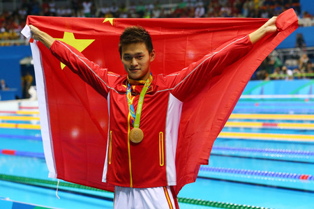 RIO DE JANEIRO, BRAZIL - AUGUST 8, 2016: Olympic champion Yang Sun of China during medal ceremony after Men's 200m freestyle of the Rio 2016 Olympics at Olympic Aquatic Stadium