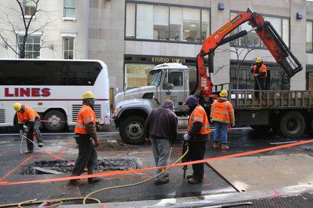 NEW YORK - MARCH 16, 2017: Verizon crew workers make emergency repair in Midtown Manhattan