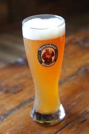 BROOKLYN, NEW YORK - MAY 25, 2017: A glass of German wheat beer Franziskaner Weissbier served in Brooklyn's restaurant.