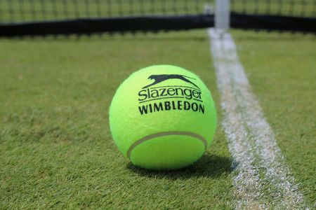 NEW YORK - JUNE 29, 2017: Slazenger Wimbledon Tennis Ball on grass tennis court. Slazenger Wimbledon Tennis Ball exclusively used and endorsed by The Championships, Wimbledon