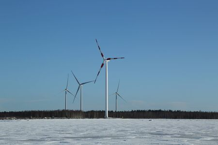Photo for Wind turbines and frozen Baltic Sea in Lapland, Finland - Royalty Free Image