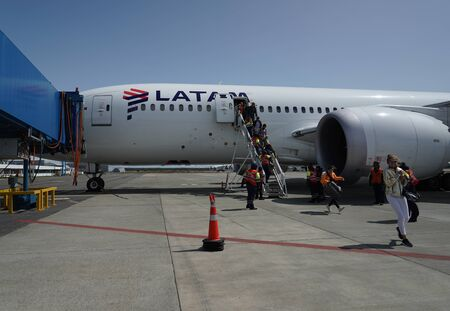 Photo pour PUNTA ARENAS, CHILE - JANUARY 30, 2020: Passengers disembark Latam Airlines plane after landing with gusting wind more than 75 miles per hour at Punta Arenas International Airport, Chile - image libre de droit