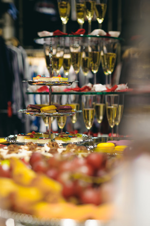 buffet table with snacks, cakes, drinks and champagne