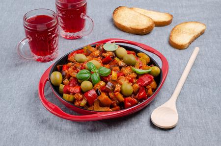 Photo pour Slices of stewed vegetables in a dish on a textile background. Selective focus. - image libre de droit