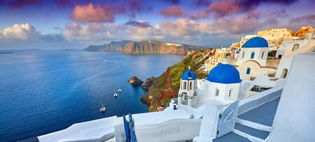Photo for Fira town on Santorini island, Greece. Incredibly romantic sunrise on Santorini. Oia village in the morning light. Amazing sunset view with white houses. Island of lovers - Royalty Free Image