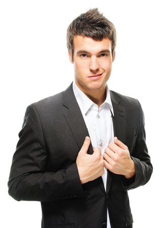 Portrait of young attractive dark-haired man wearing shirt and black jacket against white background.