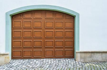 Arched Wooden Garage Doors In A Modern House Lizenzfreie Bilder