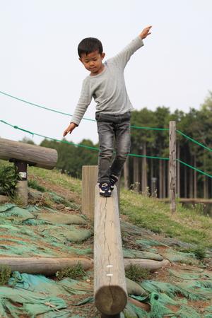 Japanese boy on the balance beam