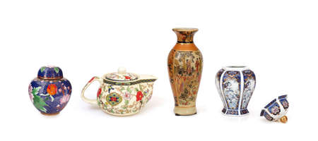 Photo pour Chinese dishes (teapot, vase, casket) isolated on a white background - image libre de droit
