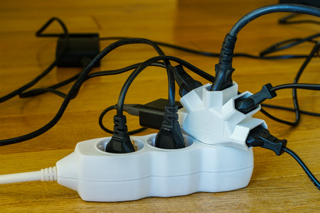 Multi socket with connected power Strip with a bunch of plugs on blurred background