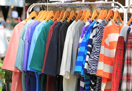 Photo pour Casual clothes hang on clothes rack for sale. - image libre de droit