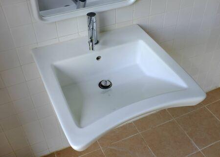 Photo pour Close up white sink in the toilet room. - image libre de droit