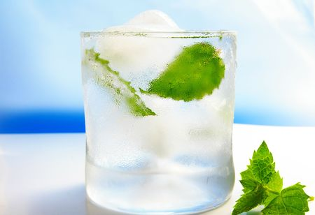 mojito cocktail with fresh mint, on blue