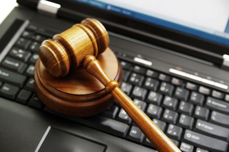 judges gavel on a laptop computer (cyber law)