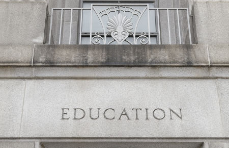Exterior of a building with Education engraved in stone