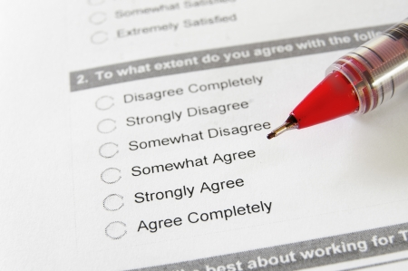 Closeup of an employment survey with red pen
