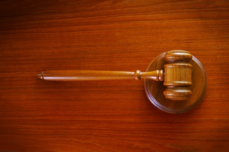 legal court gavel on a desk, top view