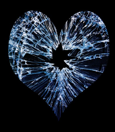Photo pour heart shaped shattered glass with a hole in the middle                                - image libre de droit