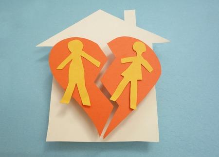 Paper couple on a split house - divorce concept