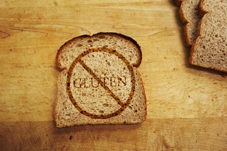 Slice of bread with Gluten text - Gluten Free diet concept