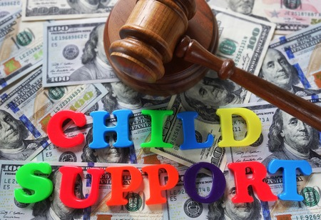 Child Support letters with gavel and cash