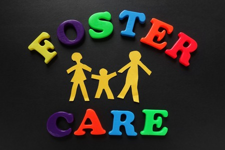 Paper cutout people with Foster Care letters