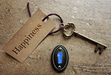Photo for Lock and gold key with Happiness label - Royalty Free Image