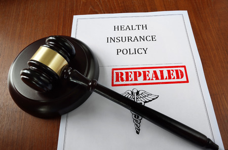 Health Insurance Policy document with court gavel and Repealed stamp