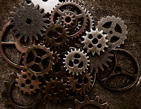 Photo pour Assortment of  metal gears on grunge background - image libre de droit