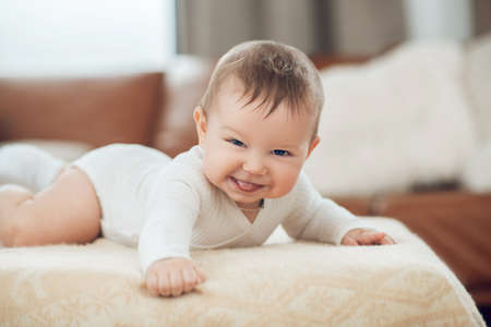 Photo for Laughing little kid lying on his stomach - Royalty Free Image