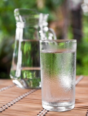 drinking water in glass on the table