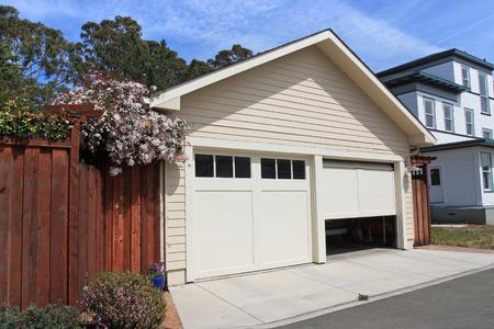 Photo pour Open garage door in suburban house - image libre de droit