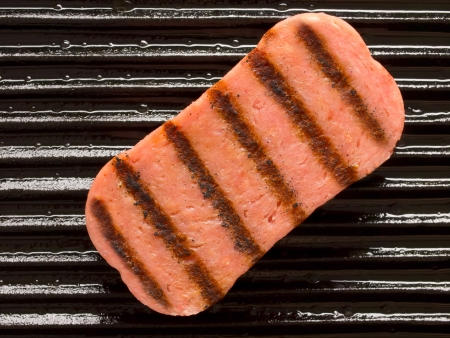 close up o spam on a grill
