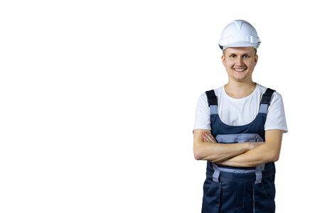 Photo pour successful engineer and white helmet with folded arms, isolated on white background. - image libre de droit
