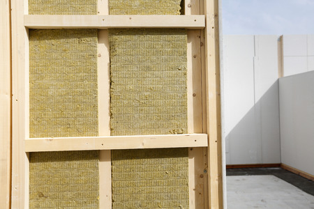 Insulated frame for prefabricated house at construction site