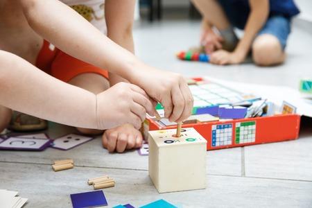 Foto de Children playing with homemade, do-it-yourself educational toys. Learning through experience concept. - Imagen libre de derechos