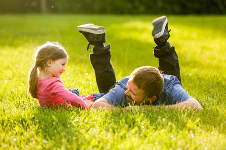 Photo for Devoted father and daughter enjoying eachothers company, bonding, talking, having fun in nature on a bright, sunny day. - Royalty Free Image