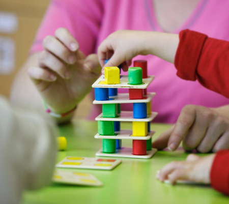 Photo pour Children playing with homemade, do-it-yourself educational toys, stacking and arranging colorful pieces. Learning through experience concept, gross and fine motor skills, back to school concept. - image libre de droit