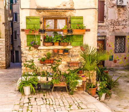 Photo pour Flowers In Front Of Old Brick Building-Rovinj, Istria, Croatia, Europe - image libre de droit