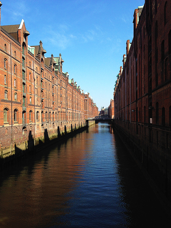 Hamburg city warehouse with red brick buildings, traveling.