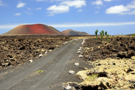Volcanic Lanzarote landscape Dirt road to the Mountain Colorado  Spain