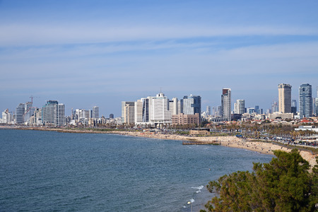Photo pour Tel Aviv, Israel - April 05, 2019: Tel Aviv skyline off the shore of the Mediterranean sea. View from the Jaffa Promenade - image libre de droit