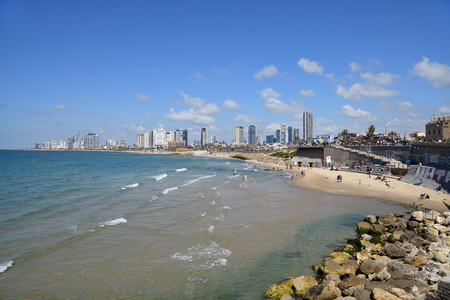 Photo for Tel Aviv, Israel - April 05, 2019: Tel Aviv skyline off the shore of the Mediterranean sea. View from the promenade - Royalty Free Image