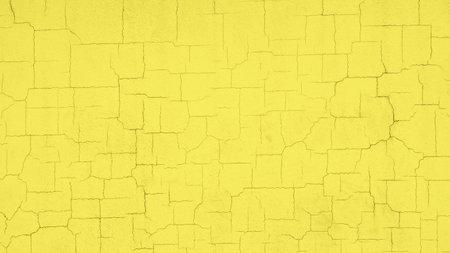 Photo pour Textured cracked pastel yellow wall vivid background - image libre de droit