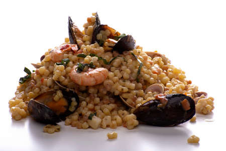 Foto de Sardinian fregola with seafood on a white background - Imagen libre de derechos